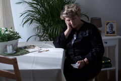 Widow is worried about death Stock Photos