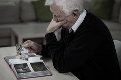 Widower remembering deceased wife Stock Images