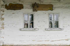 Widows in wooden building Stock Photo