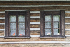 Widows in wooden building Royalty Free Stock Photos