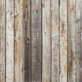 Wieśniak wietrzał stajni drewnianego tło z kępkami i gwóźdź dziurami Obraz Stock