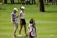 Wie discusses with her caddy at LPGA Malaysia Stock Photo