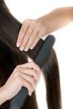 Wie man Haar geraderichtet Stockfotos
