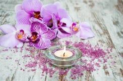 Świeczka z orchideami Zdjęcie Royalty Free
