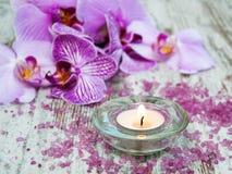 Świeczka z orchideami Obrazy Royalty Free