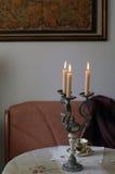 Świeczki w candlestick w rocznika stylu Zdjęcie Stock