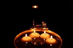 Świeczki w wodzie Obrazy Royalty Free