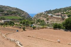 Wied Babu Zurrieq Malta. Wied Babu, at Wied iz-Zurrieq, green rocky valley, leading down to the azure turquoise water of the Blue Grotto, Zurrieq, Malta, May Royalty Free Stock Images
