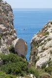 Wied Babu Zurrieq Malta. Wied Babu, at Wied iz-Zurrieq, green rocky valley, leading down to the azure turquoise water of the Blue Grotto, Zurrieq, Malta, May Stock Photography
