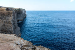 Wied il Mielah canyon, natural arch over the sea. Gozo, Malta Stock Image