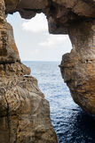 Wied il Mielah canyon, natural arch over the sea. Gozo, Malta Royalty Free Stock Photos