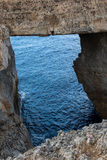 Wied il Mielah canyon, natural arch over the sea. Gozo, Malta Royalty Free Stock Image