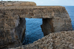 Wied il Mielah canyon, natural arch over the sea. Gozo, Malta Stock Photography