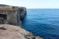 Wied il Mielah canyon, natural arch over the sea. Gozo, Malta Royalty Free Stock Photo