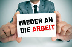Wieder an die arbeit, back to work in german Stock Photos
