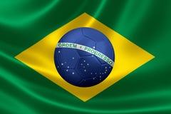 Wiedergabe 3D des Fußballs im Herzen einer brasilianischen Flagge Lizenzfreie Stockfotos