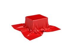 Wiedergabe 3d eines Stückes roter Satinkleidung ist wahrscheinlich, einen Kasten zu verstecken, der auf weißem Hintergrund lokali Stockfoto