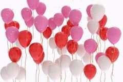Wiedergabe 3D von rosa, roten, weißen Ballonen auf weißem Hintergrund Lizenzfreies Stockfoto