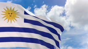Wiedergabe 3D von Uruguay fahnenschwenkend auf Hintergrund des blauen Himmels mit Alphakanal stock video