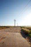 Wiejska droga i niebieskie niebo Zdjęcia Royalty Free