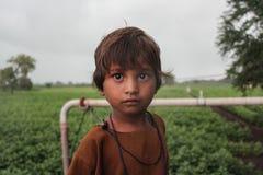 Wiejski dzieciak z dużymi oczami Obrazy Royalty Free