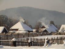 Wiejski krajobraz z dymienie kominami Obraz Royalty Free