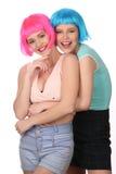 Wieki dojrzewania w kolorowy peruk ściskać z bliska Biały tło Zdjęcia Royalty Free