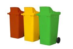 Wielcy kolorowi śmieciarscy kosze odizolowywają na białym tle Fotografia Stock