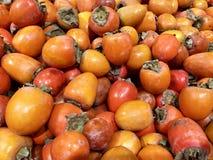 Wiele świeżych owoc persimmons w supermarkecie, karmowy pojęcie zdjęcia royalty free