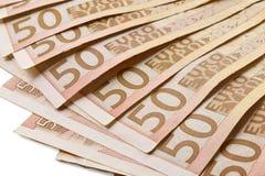 Wiele 50 euro banknotów wachlujących odizolowywającymi Zdjęcia Royalty Free