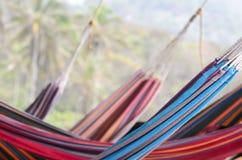 Wiele kolorowi hamaki wiesza za each inny zdjęcie royalty free