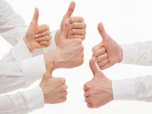 Wiele ludzie biznesu pokazuje kciuk up podpisują Zdjęcie Royalty Free