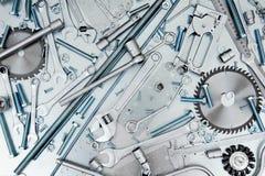 Wiele narzędzia na porysowanym metalu tle Fotografia Royalty Free