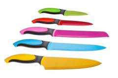 Wiele oryginalni barwioni noże Na biały tle Zdjęcia Royalty Free