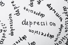 Wiele pisać słów depresja na białej księdze jako tło fotografia stock
