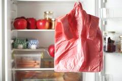 Wiele plastikowi worki zbliżają chłodziarkę z produktami obrazy stock