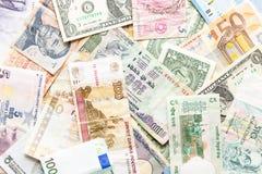 Wiele różne waluty jako tło Obrazy Stock