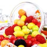Wiele różni kolorowi cukierki i guma do żucia obrazy stock