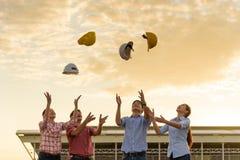 Wiele rasy Konstruują rzucać up kapelusz dla świętują po projekta Zdjęcia Royalty Free