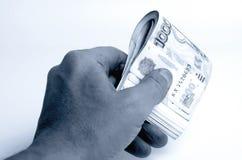 Wiele ruble w ręce obraz stock