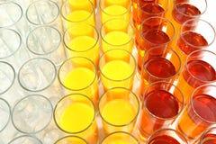 Wiele szkła z różnym sokiem Zdjęcie Stock