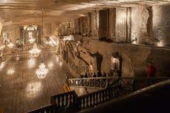 Wieliczka, Poland. St. Kinga Chapel. Wieliczka - Polska - April 23. Tourists walk down to main Wieliczka Mine Salt Museum attraction - St. Kinga Chapel located Stock Photography
