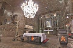Wieliczka Salt Mine. KRAKOW, POLAND - APRIL 28th: Chapel in the main hall in the Wieliczka Salt Mine (13th century), one of the world's oldest salt mines. April Stock Photo