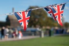 Wielka Brytania świętowania chorągiewka z typowym UK tłem wewnątrz Zdjęcie Stock