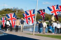 Wielka Brytania świętowania chorągiewka z typowym UK tłem wewnątrz Obrazy Stock