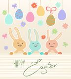 Wielkanocna karta z ślicznymi królikami i jajkami Obraz Royalty Free