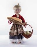 Wielkanocna lala pełno z chlebem i bascet jajka Obrazy Stock