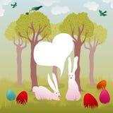 Wielkanocnego królika para z ptakami i malującymi jajkami Zdjęcia Royalty Free