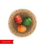 Wielkanocni barwioni jajka w gniazdeczku Obrazy Royalty Free