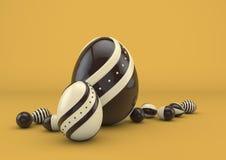 Wielkanocni czekoladowi jajka na pomarańczowym tle Obrazy Stock